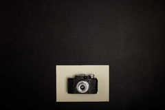 Vintage film camera on office table. Top view Royalty Free Stock Photos
