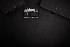 Vintage film camera on office table. Top view Royalty Free Stock Photography