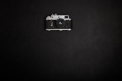 Vintage film camera on office table. Top view Stock Images