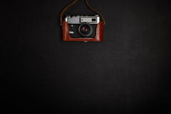 Vintage film camera on office table. Top view Royalty Free Stock Images
