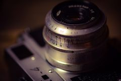 Vintage film camera. Old 35 mm film photocamera Royalty Free Stock Images