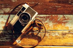 vintage film camera on old wooden Royalty Free Stock Photo