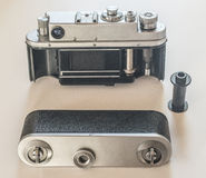 Vintage film camera open back view. Vintage rangefinder film analog Leica style camera with standard 50 mm lens. Leica thread mount 39 mm. Back view with cloth Royalty Free Stock Images