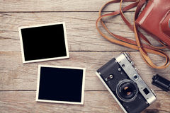 Vintage film camera and two blank photo frames Stock Image