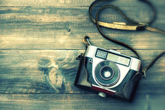 Vintage film camera on wooden background. Instagram style Stock Photos