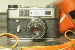 Vintage Film Camera. Is On Wooden Shelf At Home Stock Photography