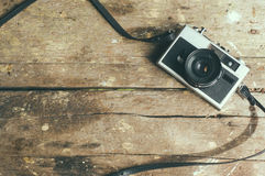 Vintage film camera on wooden table.  Stock Image