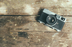 Vintage film camera on wooden table.  Royalty Free Stock Photo