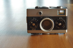 Vintage film camera. On wooden table top Stock Images