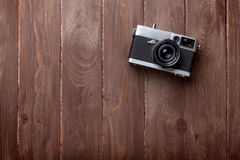 Vintage film camera on wooden table. Top view with copy space Royalty Free Stock Images