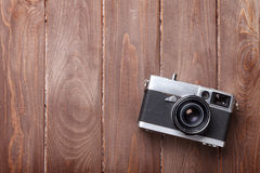 Vintage film camera on wooden table. Top view with copy space Royalty Free Stock Photography