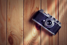 Vintage film camera on wooden table. Top view with copy space Royalty Free Stock Photo