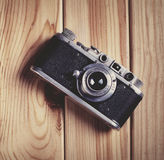 Vintage film camera on wooden table. Top view with copy space Stock Images