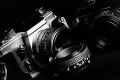 Vintage cameras and lenses on a black background. Vintage film cameras and lenses on a black background Royalty Free Stock Photography