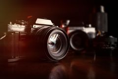 Vintage  film cameras and lenses Royalty Free Stock Photos