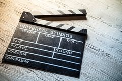 Vintage film clapper on wooden desk royalty free stock photos
