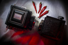 Vintage film equipment and red chili peppers Royalty Free Stock Photo
