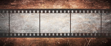 Vintage film negative on grunge old background Royalty Free Stock Photo