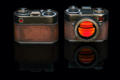 Vintage film photo camera in black studio. 3d render Royalty Free Stock Photography