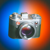 Vintage film photo camera on color background Royalty Free Stock Photography