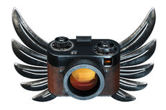 Vintage film photo camera with metal Wings on black background. Stock Image