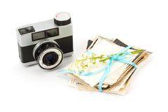 Vintage film photo-camera and old photos . Royalty Free Stock Photo