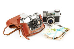 Vintage film photo-camera and old photos . Stock Images