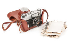 Vintage film photo-camera and old photos . Stock Photo