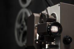 Vintage film projector. Dark background Stock Photos