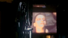 35 mm movie film projector. Vintage Film Projector in 35mm, You see the car turn while projecting the movie stock video