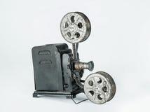 Vintage film projector. A retro cine camera on a plain grey background Stock Photo