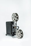 Vintage film projector. A retro film projector on a plain grey background Royalty Free Stock Photos