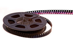 Vintage film reel. Single old 8 mm film reel partially unwound Stock Photography
