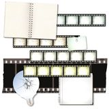 Vintage film strip background with notebooks and cracked light bulb. Design element Royalty Free Stock Image