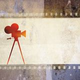 Vintage film strip background and old cinecamera Stock Photos