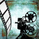 Vintage film strip background and old projector. Design element Stock Photography
