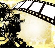 Vintage film strip background and old projector Royalty Free Stock Photo