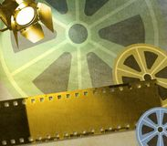 Vintage film strip background with reels and reflector Royalty Free Stock Images