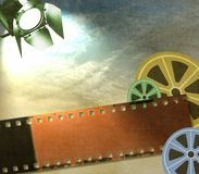 Vintage film strip background with reels and reflector Stock Image