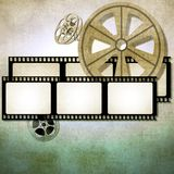 Vintage film strip background with reels Stock Photos