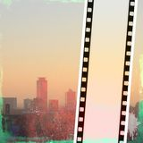 Vintage film strip frame on red city skyline. With copy space Royalty Free Stock Images