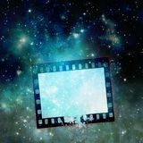 Vintage film strip frame on starry sky. Blue tones Stock Photography
