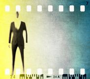 Vintage film strip frame with stylized male figure Stock Photos