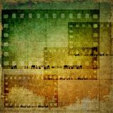 Vintage film strip frames background. In green and sepia tones Royalty Free Stock Images