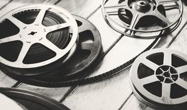 Vintage film strip isolated on wooden floor royalty free stock photos