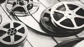 Vintage film strip isolated on wooden floor royalty free stock photo