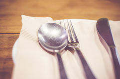 Vintage filter : Close up spoon,fork,knife on dinner table Stock Images