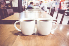 Vintage filter, couple of White coffee cup on wood table with bl stock photos