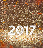 Vintage filter : happy new year 2017 year number with confetti a. T sparkling golden glitter background ,Holiday Greeting card,leave space for adding your Royalty Free Stock Images