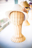 Vintage filter : lady hat on a wickerwork mannequin head Royalty Free Stock Photography